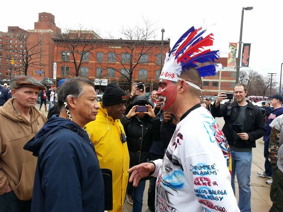 Pictured at left is Robert Roche, a Chiricahua Apache tribe member, AIM member, Executive Director of the American Indian Education Center in Parma, Ohio, and more. At right is Cleveland Indians baseball fan Pedro Rodriguez, who is not a Native American.