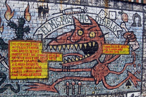 """el misisimo diablo,"" one wallpiece on the ever-changing Clarion Alley in SF's Mission, a neighborhood that still prides itself on its murals"