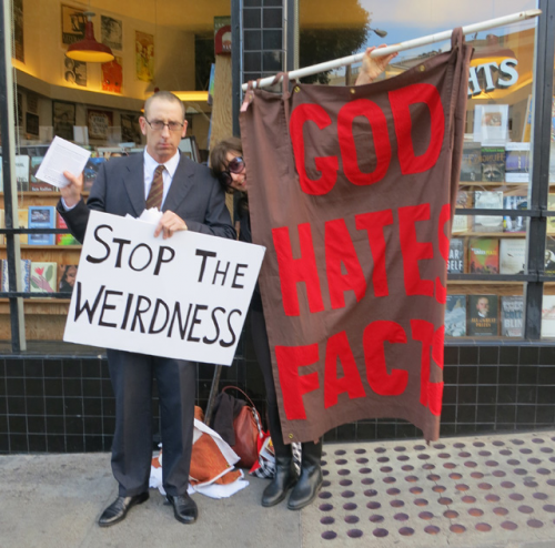Next, it was the Tales of the SF Cacophony Society book opening party at City Lights Bookstore. The Ladies' Guide to the Apocalypse was there with a homemade poli-tickle sign, and other protestors had similar ideas. Photo: Rusty Blazenhoff