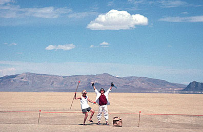 "In 1995-96, the first trash fence was tested at Burning Man. Concieved by Larry Breed (playa name Ember), several hundred yards of 24"" high netting was set up down-wind on the north side of the encampment to catch wind-blown trash. The Black Rock is visible to the right in the background of this photo."" - Danger Ranger (Photo by from Breed's collection)"