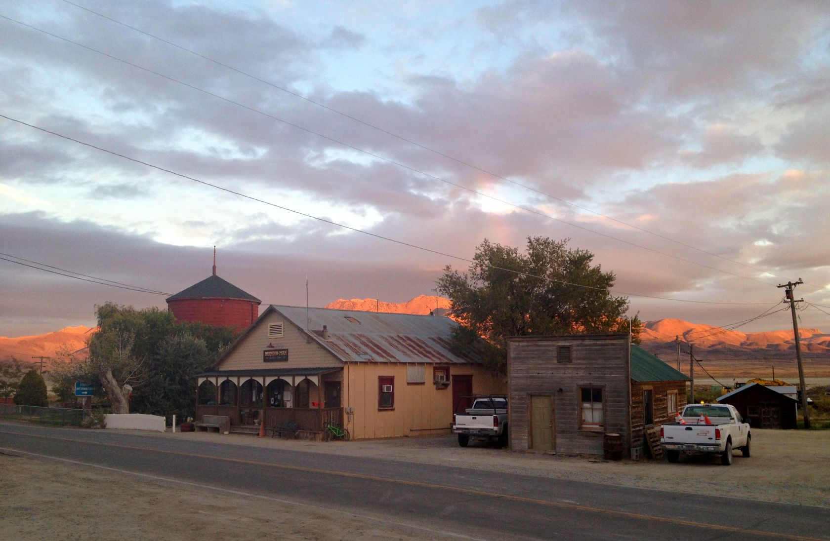 Sun sets across from Burning Man's main office in this old cowboy town, with the auxiliary office to the right that's actually an old jailhouse. Come in to get a charged battery for your crew radio; stay for the fantasies about what kind of folks had been incarcerated in there before we were even alive.