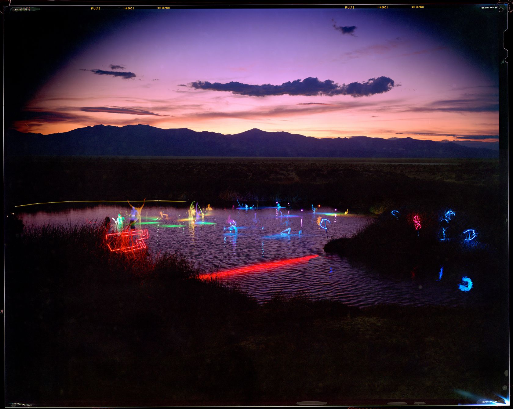 William Binzen's 'Black Rock Hot Springs - Blessed by Water Sprites and Submerged Neon - Commencing Desert Siteworks,' 1993