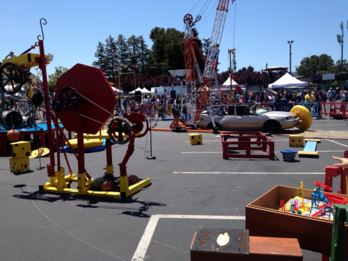 """Speaking of crushing things, the Lifesize Mousetrap's two-ton safe whomped the above vehicle for cheering throngs at Maker Faire all weekend. We sold T-shirts in the merch shack while clowngineers wrenched on the Rube Goldbergian sculpture with dancing mice, and Esmerelda Strange's """"The Machine Is Broken"""" song stuck in our heads."""