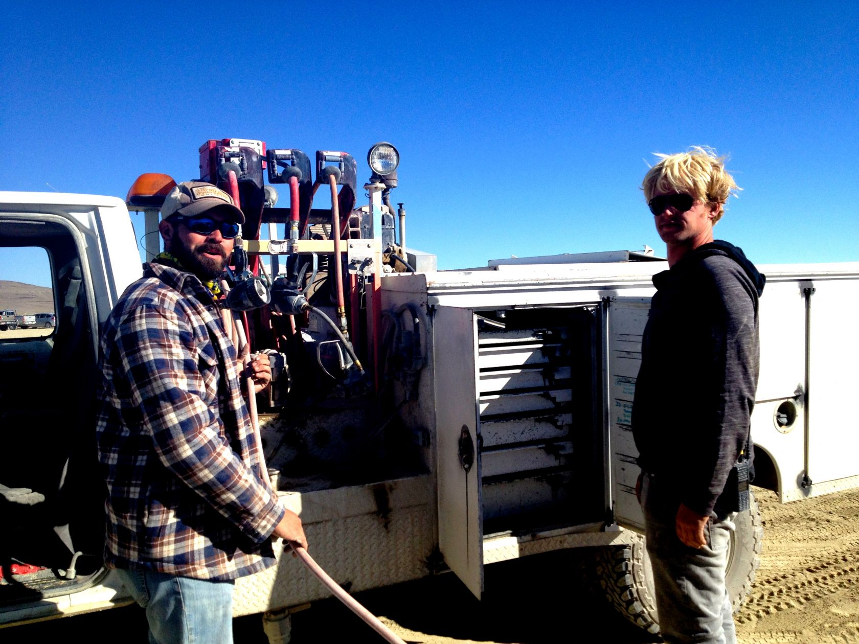Perrier and Edelweiss from DPW Fleet maintain vehicles on the shoreline with the mobile Auto Shop rig.