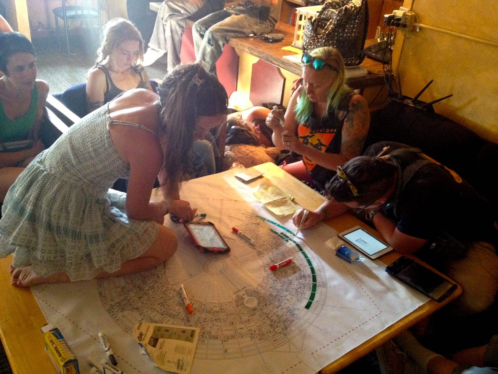 Scribes pore over the MOOP map and color in their sections during the daily MOOP Map Coloring Party in the Black Rock Saloon in Gerlach.