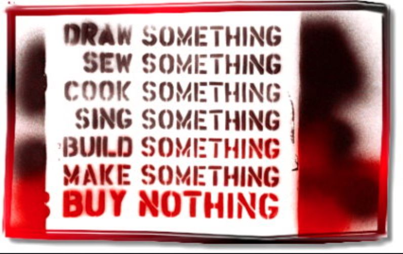 A graffiti banner urges people to make things instead of buying things.